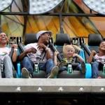 Eunice Arias Soto, left, and Juan Beras were joined by their daughter Maria Beras, right, and family friend Layla Smith while enjoying a ride at the Marshfield Fair on Aug. 21, 2015. This year's fair runs through Aug. 27.