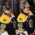 Boston-01/05/2017-Boston Bruins vs Oilers. Bruins goalie Tuukka Rask is on the bench with less than a minute left in the game after he was pulled with the Bruins down 4-3. Backup goalie Anton Khudobin(left) and Kevan Miller(rt) watch. John Tlumacki/Boston Globe(sports)