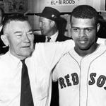 Boston, MA - 10/11/1967: Boston Red Sox owner Tom Yawkey, left, stands with Red Sox player Reggie Smith after the Red Sox defeated the St. Louis Cardinals in Game 6 of the World Series at Fenway Park in Boston on Oct. 11, 1967. The Red Sox forced a Game 7 by winning, 8-4. (Frank O'Brien/Globe Staff) --- BGPA Reference: 170322_MJ_041