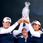 WEST DES MOINES, IA - AUGUST 20: Angel Yin and Lizette Salas of Team USA hold up the Solheim Cup after defeating Team Europe 16 1/2 to 11 1/2 during the final day singles matches of the Solheim Cup at the Des Moines Golf and Country Club on August 20, 2017 in West Des Moines, Iowa. (Photo by Harry How/Getty Images)