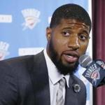 FILE - In this Wednesday, July 12, 2017, file photo, Oklahoma City Thunder forward Paul George answers a question at his first news conference since Oklahoma City's blockbuster trade with the Indiana Pacers, in Oklahoma City. On Sunday, Aug. 20, 2017, the NBA said it has opened an investigation to see if the Los Angeles Lakers tampered with George while he was under contract with the Indiana Pacers. The probe is being handled by the New York-based law firm of Wachtell, Lipton, Rosen & Katz, and the NBA said the Lakers have cooperated with the ongoing investigation. (AP Photo/Sue Ogrocki, File)