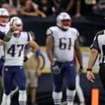 Tom Brady signals to the official that the New Orleans Saints had 12 players on the field.