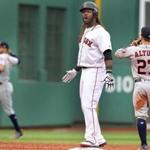 Boston, MA: October 8, 2017: Red Sox DH Hanley Ramirez reacts to his teammates in the dugout follolwing his bottom of the third inning RBI double. The Boston Red Sox hosted the Houston Astros in Game Three of an ALDS baseball game at Fenway Park. (Jim Davis/Globe Staff).