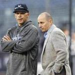 New York Yankees manager Joe Girardi, left, and general manager Joe Girardi chat on the field before the team's American League wild-card playoff baseball game against the Minnesota Twins in New York, Tuesday, Oct. 3, 2017. (AP Photo/Kathy Willens)