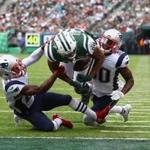 Malcolm Butler (left) caused Austin Seferian-Jenkins (center) to lose control of the football just outside the end zone.