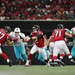 Atlanta Falcons quarterback Matt Ryan (2) pitches the ball to Atlanta Falcons running back Devonta Freeman (24) against the Miami Dolphins during the first half of an NFL football game, Sunday, Oct. 15, 2017, in Atlanta. (AP Photo/David Goldman)