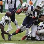 New England Patriots' Mike Gillislee (35) fumbles the ball as New York Jets' Darron Lee (58) tackles him during the first half of an NFL football game Sunday, Oct. 15, 2017, in East Rutherford, N.J. (AP Photo/Bill Kostroun)