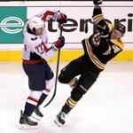 Boston, MA - 11/04/2017 - (2nd period) Boston Bruins right wing David Pastrnak (88) is sent flying by an open ice hit from Washington Capitals right wing T.J. Oshie (77) during the second period. The Boston Bruins host the Washington Capitals at TD Garden. - (Barry Chin/Globe Staff), Section: Sports, Reporter: Fluto Shinzawa, Topic: 05Capitals-Bruins, LOID: 8.3.4204540732.