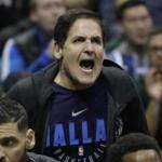 Dallas Mavericks owner Mark Cuban yells after a technical foul during the second half of an NBA basketball game against the Milwaukee Bucks Friday, Dec. 8, 2017, in Milwaukee. The Bucks won 109-102. (AP Photo/Morry Gash)