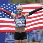 Shalane Flanagan of the United States poses for pictures after crossing the finish line first in the women's division of the New York City Marathon in New York, Sunday, Nov. 5, 2017. (AP Photo/Seth Wenig)