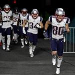 Miami Gardens, FL - 12/11/2017 - (pre) New England Patriots wide receiver Danny Amendola (80) leads his teammates onto the field for pre game warmups. The New England Patriots visit the Miami Dolphins in a Monday night football game at Hard Rock Stadium, Miami Gardens, FL. - (Barry Chin/Globe Staff), Section: Sports, Reporter: James M. McBride, Topic: 12Patriots-Dolphins, LOID:8.4.335853716.