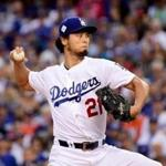 LOS ANGELES, CA - NOVEMBER 01: Yu Darvish #21 of the Los Angeles Dodgers pitches in the first inning against the Houston Astros in game seven of the 2017 World Series at Dodger Stadium on November 1, 2017 in Los Angeles, California. (Photo by Harry How/Getty Images)