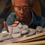 Ray Crean, a member of the USS Constitution Model Shipwright Guild, worked on a miniature of the Joseph P. Kennedy Jr.