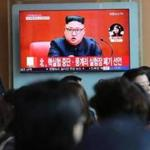 FILE - In this April 21, 2018 file photo, people watch a TV screen showing an image of North Korean leader Kim Jong Un during a news program at the Seoul Railway Station in Seoul, South Korea. The signs read: