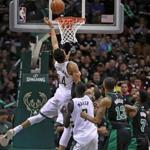 Milwaukee, WI: 4-22-18: The Bucks Giannis Antetokounmpo (34) tips home the game winning basket that gave Milwaukee a 104-102 lead with 5.1 seconds left in the game. The Boston Celtics visited the Milwaukee Bucks for Game Four of their NBA Eastern Conference first round playoff series at the Bradley Center. (Jim Davis/Globe Staff)