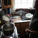 Food historian Ken Albala removes cooked noodes from boiling water.