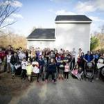 Content Folder: Regional Standing in front of the pump house are Andrews Farm development residents who are struggling to get water to their homes. Rose Lincoln for the Boston Globe