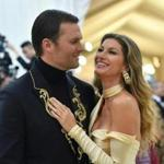 Tom Brady (L) and Gisele Brundchen arrive for the 2018 Met Gala on May 7, 2018, at the Metropolitan Museum of Art in New York. / AFP PHOTO / Angela WEISSANGELA WEISS/AFP/Getty Images