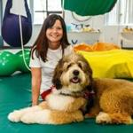 Jan Wade, owner of Boston Ability Center in Wellesley Hills and Natick, with therapy dog Stanley.