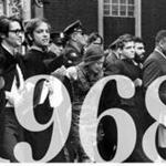 At Harvard's 1968 commencement, police removed demonstrators from Harvard Yard. The group was protesting the choice of the Shah of Iran as commencement speaker. Third from right is Donald King.