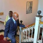 Representative John Lewis walks up the stairs past a photograph of Martin Luther King Jr. at the Twelfth Baptist Church in Roxbury on Saturday.