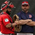 Fort Myers, FL - 2/21/2017 - Boston Red Sox catcher Sandy Leon (3) with Jason Varitek, Special Assistant to the President of Baseball Operations after catching a bullpen session. Red Sox Spring Training. Team workouts. Day Nine at Jet Blue Park in Fort Myers, FL. - (Barry Chin/Globe Staff), Section: Sports, Reporter: Peter Abraham, Topic: 21Red Sox, LOID: 8.3.1672832095.