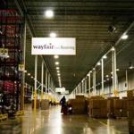 FILE-- A worker inside the Wayfair distribution center in Cranbury, N.J., April 13, 2017. Internet retailers can be required to collect sales taxes in states where they have no physical presence, the Supreme Court ruled on June 21, 2018. State officials in South Dakota sued three online retailers, including Wayfair, for violating a law that required merchants to collect sales tax. (John Taggart/The New York Times)
