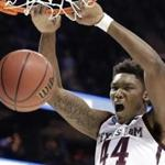 Texas A&M's Robert Williams dunks against Providence during the second half of a first-round game in the NCAA men's college basketball tournament in Charlotte, N.C., Friday, March 16, 2018. (AP Photo/Gerry Broome)