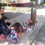 Mourners gathered at a sidewalk memorial, on Lawton Avenue in Lynn, for 25-year-old Romel Danis, who shot early Saturday.
