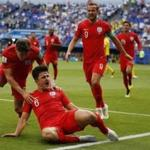 England's Harry Maguire reacts after scoring his side opening goal during the quarterfinal match between Sweden and England at the 2018 soccer World Cup in the Samara Arena, in Samara, Russia, Saturday, July 7, 2018. (AP Photo/Francisco Seco)