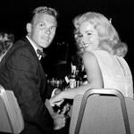 Tab Hunter at a Los Angeles dinner reception with actress Tuesday Weld in 1959.