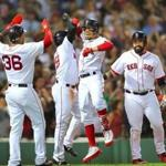 Mookie Betts celebrated his 4th inning grandslam at homeplate with Eduardo Nunez, Jackie Bradley Jr. and Sandy Leon.