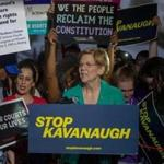 WASHINGTON, DC - JULY 09: Senator Elizabeth Warren (D-MA) speaks to protesters in front of the U.S. Supreme Court on July 9, 2018 in Washington, DC. President Donald Trump is set to announce his Supreme Court pick Monday night. (Photo by Tasos Katopodis/Getty Images)