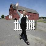 Sen. Elizabeth Warren waved as she arrived at Belkin Family Lookout Farm in Natick before a town hall event on July 8.