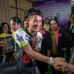 Ekkapol Chantawong from the 'Wild Boars' Thai soccer team shook hands with followers on Wednesday after the boys' first press conference since being rescued from a cave in northern Thailand.