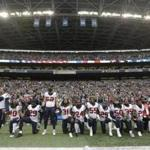 Houston Texans players knelt and stood during the singing of the national anthem before an NFL football game against the Seattle Seahawks, in Seattle in 2017.