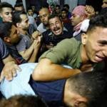 Palestinians reacted after their relative was shot dead by Israeli forces during protests east of Gaza City on Friday.