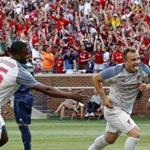 Liverpool FC Xherdan Shaqiri (R) celebrates after scoring against the Manchester United during the second half of their 2018 International Champions Cup football match at Michigan Stadium in Ann Arbor, Michigan on July 28, 2018. Liverpool FC beat Manchester United 4-1 in their friendly. / AFP PHOTO / JEFF KOWALSKYJEFF KOWALSKY/AFP/Getty Images