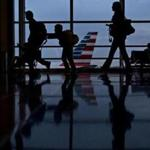 Travelers walk through Ronald Reagan National Airport (DCA) in Washington, D.C. MUST CREDIT: Bloomberg phobto by Andrew Harrer