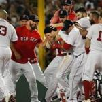 Boston MA 8/5/18 Boston Red Sox Andrew Benintendi is surrounded by his teammates after his game winning walk off hit against the New York Yankees during tenth inning action at Fenway Park. (photo by Matthew J. Lee/Globe staff) topic: reporter: