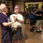John Gintell, 79, and Robert Coren, 72, at the gender-free contra dance at the First Church in Jamaica Plain.
