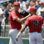 Bobby Dalbec (left) during a College World Series game in 2016.
