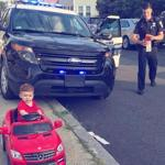 19zoblotter -- This photo of a Malden police officer pulling over a 1-year-old boy in a miniature red Mercedes became a big hit on social media. (Cori Salerno)