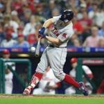 PHILADELPHIA, PA - AUGUST 14: Brock Holt #12 of the Boston Red Sox hits a pinch hit solo home run in the eighth inning during a game against the Philadelphia Phillies at Citizens Bank Park on August 14, 2018 in Philadelphia, Pennsylvania. The Red Sox won 2-1. (Photo by Hunter Martin/Getty Images)