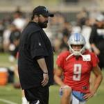 Detroit Lions head coach Matt Patricia watches players stretch as quarterback Matthew Stafford looks on during NFL football practice Tuesday, Aug. 7, 2018, in Napa, Calif. The Oakland Raiders and the Lions held a joint practice before their upcoming preseason game on Friday. (AP Photo/Eric Risberg)