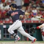CINCINNATI, OH - AUGUST 13: Jose Ramirez #11 of the Cleveland Indians singles to drive in a run in the seventh inning against the Cincinnati Reds at Great American Ball Park on August 13, 2018 in Cincinnati, Ohio. The Indians won 10-3. (Photo by Joe Robbins/Getty Images)