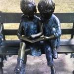 Someone stole the book off this statue of two children reading in front of the Hull Public Library.