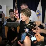 The legal action is a twist in Attorney General Maura Healey's campaign to police the so-called competitive energy market.