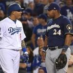 Manny Machado and Jesus Aguilar exchange words during the 10th inning.