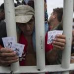 A Honduran migrant held tickets that let him and his family cross into Mexico on Saturday.